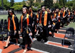 Roseburg High School graduates take the field.